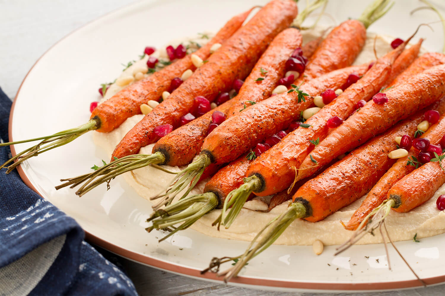 Whole-Roasted-Carrots-with-Topped-Organic-Garlic-Hommus.jpg